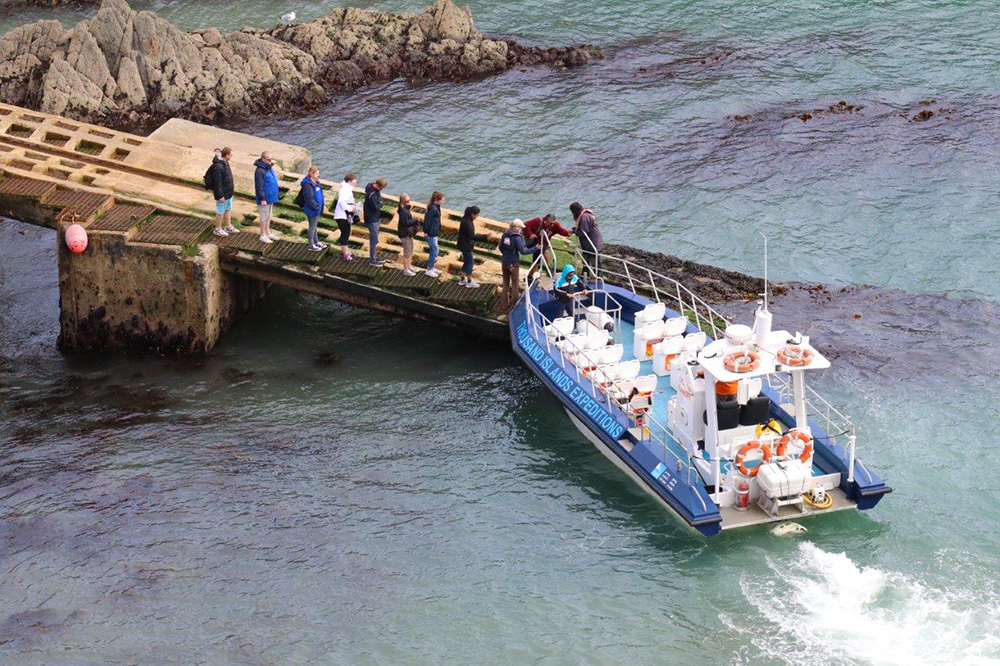 Passengers boarding Jet Boat at St Justinians Lifeboat Station